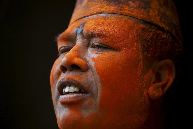A devotee smeared in vermillion powder is pictured while celebrating Sindoor Jatra vermillion powder festival at Thimi, in Bhaktapur April 15, 2015. (Photo by Navesh Chitrakar/Reuters)