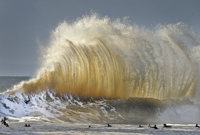 Surfers enjoy the large waves at the entrance to Santa Barbara, Calif., harbor Saturday morning, January 21, 2017. A winter storm is bringing much higher than usual waves to the area. (Photo by Mike Eliason/Santa Barbara County Fire Department via AP Photo)