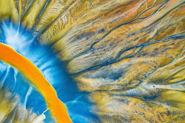 """Poisoned River. Abstract Winner. A detailed photograph of a stream filled with poison. """"Poisoned Beauty"""" is a personal project that tells the story of the natural disaster in the Apuseni Mountains in Transylvania, which was a result of chemical waste generated by copper and gold mining, but in a beautifully abstract way. (Photo by Gheorghe Popa/Drone Photography Awards 2021)"""