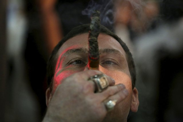 Actor Max Uralsky, from Russia, smokes as he competes for the longest ash during the XVIII Habanos Festival in Havana, March 3, 2016. (Photo by Alexandre Meneghini/Reuters)