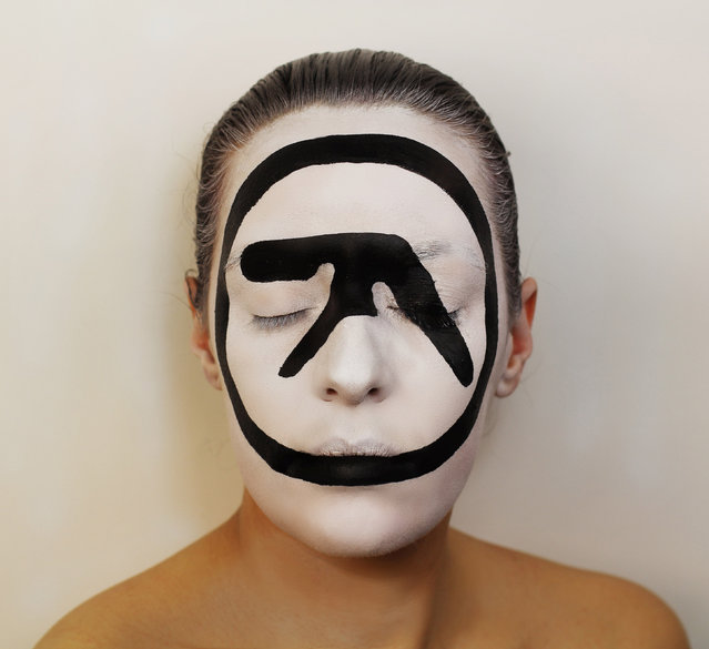 Aphex Twin album. An artist has gone to incredible lengths to paint several iconic album covers on her own face. (Photo by Natalie Sharp/Caters News)