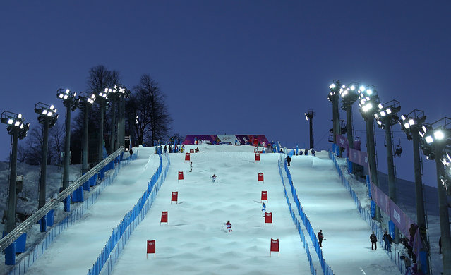 Athletes practice during training for the Moguls Competition at the Extreme Park at Rosa Khutor Mountain on February 3, 2014 in Sochi, Russia. (Photo by Mike Ehrmann/Getty Images)