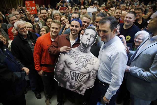 Republican presidential candidate, Sen. Ted Cruz, R-Texas, poses for photographs during a campaign stop on Sunday, March 13, 2016, in Columbus, Ohio. (Photo by Matt Rourke/AP Photo)