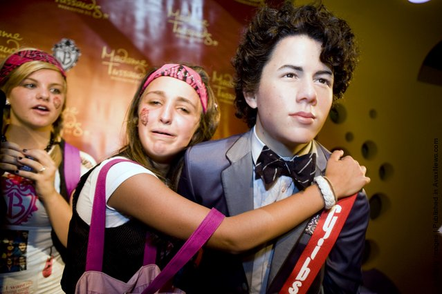 Maddy Pomilla, 14,  from Huntingtown, MD, takes a picture of herself with a wax figure of Nick Jonas of the Jonas Brothers at Madame Tussauds
