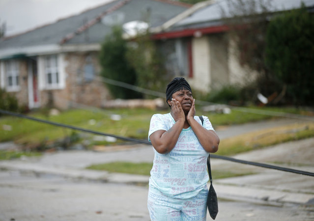 Lisa Carruth reacts as she surveys the damage after a tornado tore through the eastern part of New Orleans, February 7, 2017. The National Weather Service says at least three confirmed tornadoes have touched down, including one inside the New Orleans city limits. Buildings have been damaged and power lines are down. (Photo by Gerald Herbert/AP Photo)