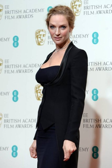 US actress Uma Thurman poses in the press room after presenting an award at the 2014 EE British Academy Film Awards at The Royal Opera House in London, Britain, 16 February 2014. (Photo by Andy Rain/EPA)