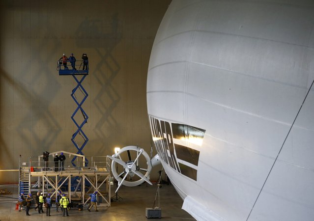 Members of the media film the Airlander 10 hybrid airship during its unveiling in Cardington, Britain March 21, 2016. (Photo by Darren Staples/Reuters)