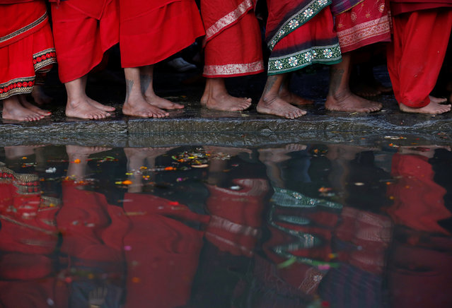 The feet of devotees are pictured as they stand on the bank of the Hanumante River during a month-long Swasthani Brata Katha festival in Bhaktapur, Nepal February 10, 2017. (Photo by Navesh Chitrakar/Reuters)