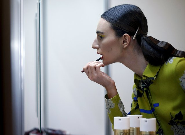 A model gets ready backstage during the Mercedes-Benz Fashion Days in Tbilisi, Georgia, May 2, 2015. (Photo by David Mdzinarishvili/Reuters)