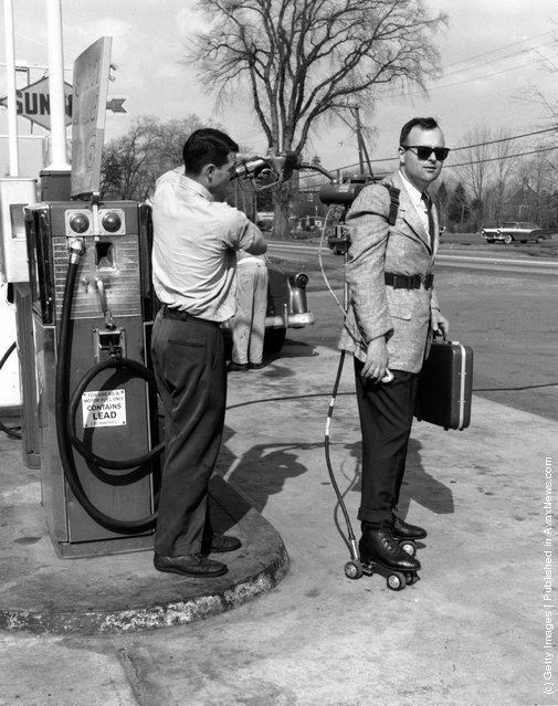 Salesman has his motorised roller skates refuelled at a petrol station near Hartford, Connecticut