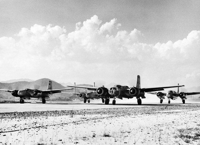 Engines of U.S. Air Force B-26 bombers are revved up shortly before taking off from Far East Air Force field in Japan on September 20, 1950, for combat missions in Korea. The twin-engine bombers were flying round-the-clock missions in support of United Nations ground forces. (Photo by AP Photo/U.S. Air Force via The Atlantic)