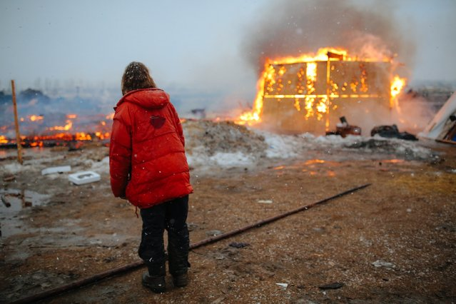 Campers set structures on fire in preparation of the Army Corp's 2pm deadline to leave the Oceti Sakowin protest camp on February 22, 2017 in Cannon Ball, North Dakota. (Photo by Stephen Yang/Getty Images)