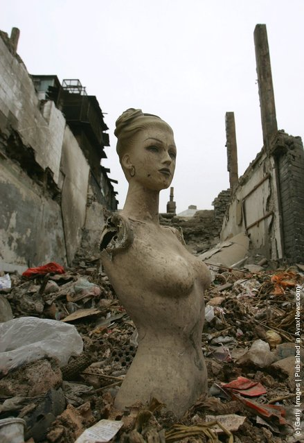 A sculpture is seen among the ruins of buildings