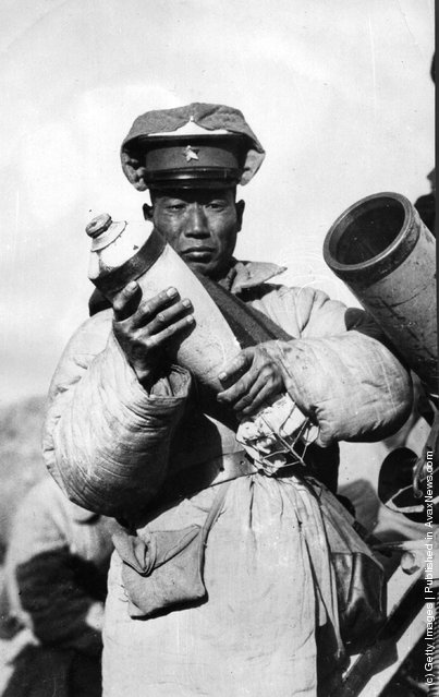 1927: A soldier in Chang Tsung Chang's army holding a mortar bomb