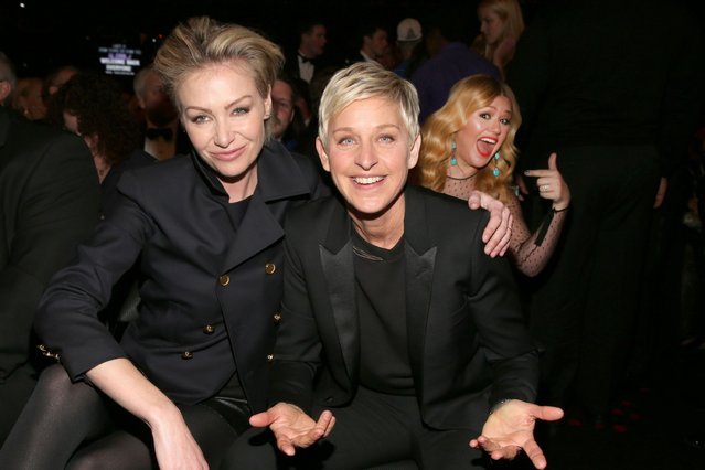 Singer Kelly Clarkson photobombs actress Portia de Rossi and Ellen DeGeneres at the GRAMMY Awards in 2013. (Photo by Christopher Polk/Getty Images)