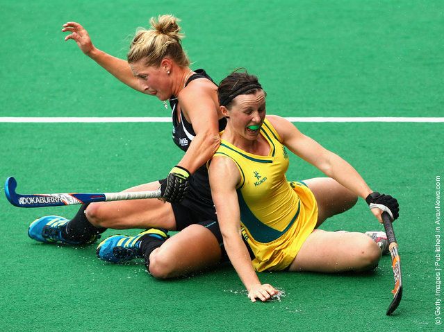 Claire Messent of the Hockeyroos competes with Sophie Devine of the Blacksticks during the Oceania Cup match between  New Zealand and Australia
