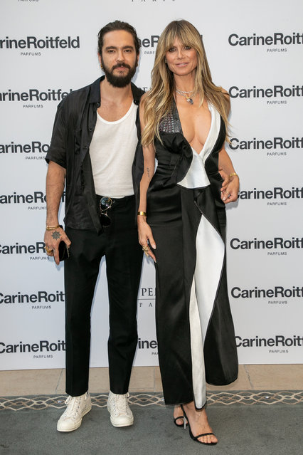 """(L-R) Tom Kaulitz and Heidi Klum attend the Carine Roitfeld Parfums """"7 lovers"""" : Cocktail At The Peninsula Hotel In Paris on July 01, 2019 in Paris, France. (Photo by Marc Piasecki/Getty Images)"""