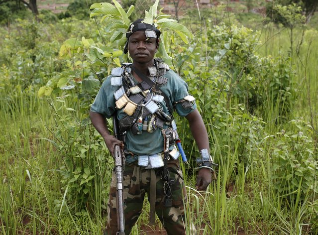 A member of the anti-balaka, a Christian militia, stands during a patrol outside the village of Zawa April 8, 2014. (Photo by Goran Tomasevic/Reuters)