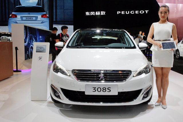 Visitors gather at the Peugeot booth during Auto China 2016 auto show in Beijing April 25, 2016. (Photo by Kim Kyung-Hoon/Reuters)