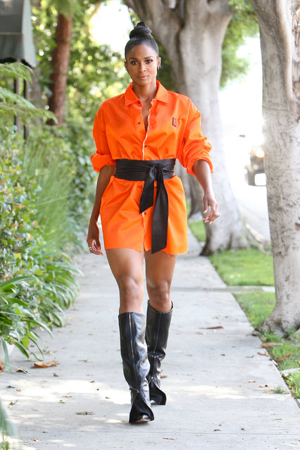 Ciara is captured outside a studio after taping America's Most Musical Family in Los Angeles, California on July 26, 2019. The singer stunned in her orange outfit and tall zippered boots. (Photo by Splash News and Pictures)
