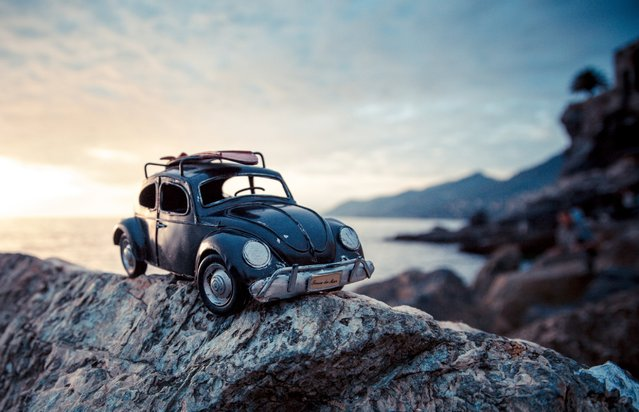 "Kim Leuenberger is a Swiss photographer with a love for travel. She believes we are all explorers and is currently studying photography at University of the Arts London. These photos are from her series, ""Traveling Cars Adventures"". ""Riding the Shore"", Black Volkswagen Beetle, Camogli, Italy, October 2012. (Photo by Kim Leuenberger)"