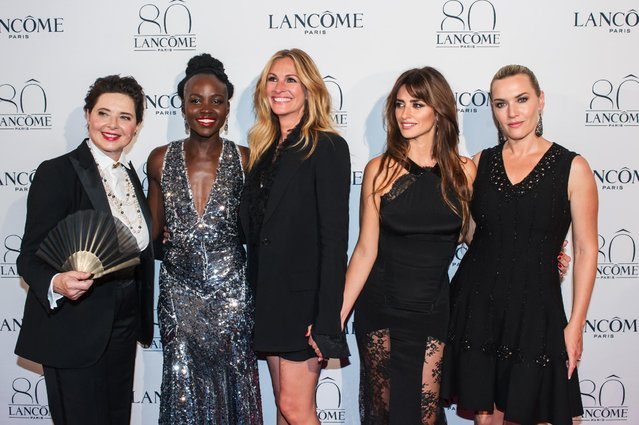 From left, Isabella Rossellini, Lupita Wyong'o, Julia Roberts, Penelope Cruz, and Kate Winslet pose during a photocall for the Lancome 80th anniversary party during the Haute Couture fashion week in Paris, France, Tuesday, July 7, 2015. (Photo by Kamil Zihnioglu/AP Photo)