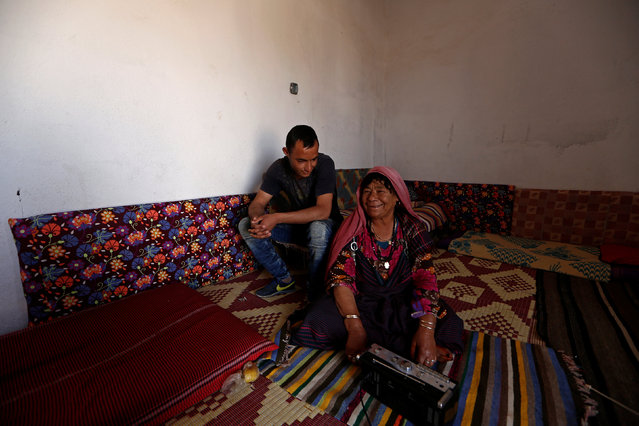 Yarusi Kadi, 21 (C), an unemployed graduate, smiles as he poses for a photograph with his grandmother at his house in the town of Remada, Tunisia April 11, 2016. (Photo by Zohra Bensemra/Reuters)