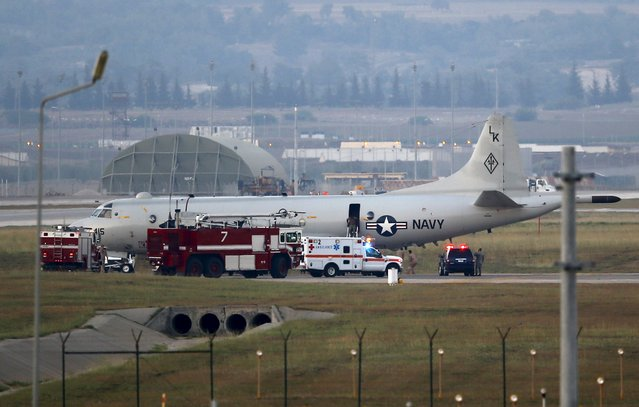 Fire trucks and and an ambulance are seen next to a U.S. Navy P-3 Orion Maritime patrol aircraft after it landed at Incirlik airbase in the southern city of Adana, Turkey, July 25, 2015. (Photo by Murad Sezer/Reuters)
