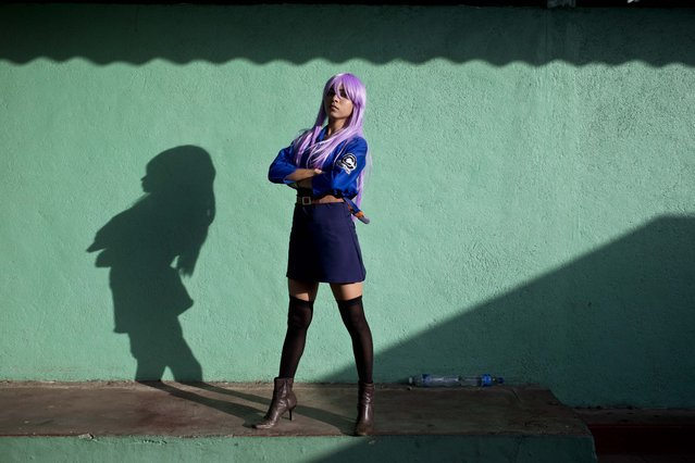 Cosplayer Monzerath Gutierrez, who portrays Dragon Ball Z character Trunks, female version, poses for a portrait during the 4th edition of the MiniCon Anime convention, at the School of Dance, in Managua, Nicaragua, Sunday, July, 26, 2015. (Photo by Esteban Felix/AP Photo)
