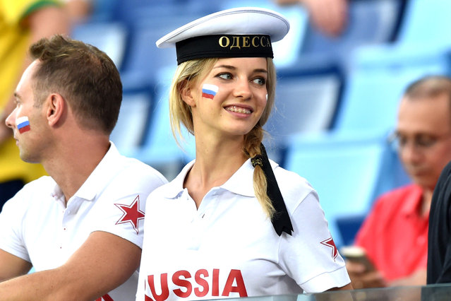 Russia fans attend the 2014 FIFA World Cup Group H football match between Russia and South Korea in the Pantanal Arena in Cuiaba on June 17, 2014. (Photo by Kirill Kudryavtsev/AFP Photo)