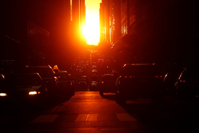 The sun sets while lined up with 42nd Ave a few days after the Manhattanhenge phenomenon in the Manhattan borough of New York City, New York, U.S. May 31, 2017. (Photo by Carlo Allegri/Reuters)