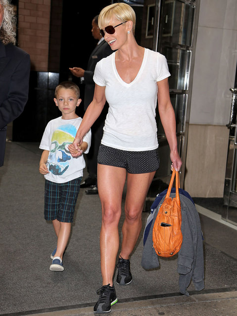Jaime Pressly seen smiling and holding onto her son Dezi James Calvo as they leave their hotel in New York City. (Photo by Santi/Splash News)