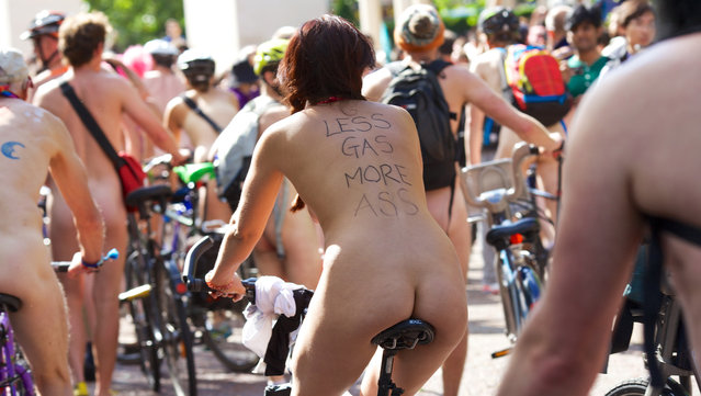 World Naked Bike Ride, London, Britain, 14 June 2014. Hundreds of people riding their bikes naked in London as protest against motor vehicles. (Photo by Andre Camara/Rex Features)