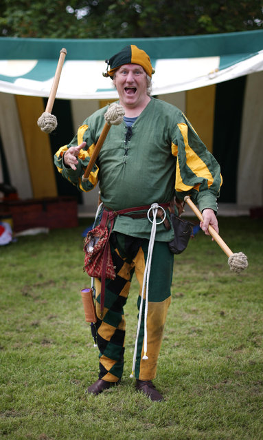 A man dressd as an 8th century jester performs at the Bannockburn Live event on June 28, 2014 in Stirling, Scotland. The 700th anniversary of the historic battle that saw the outnumbered Scots conquer the English led by Edward II in the First War of Scottish Independence. (Photo by Peter Macdiarmid/Getty Images)
