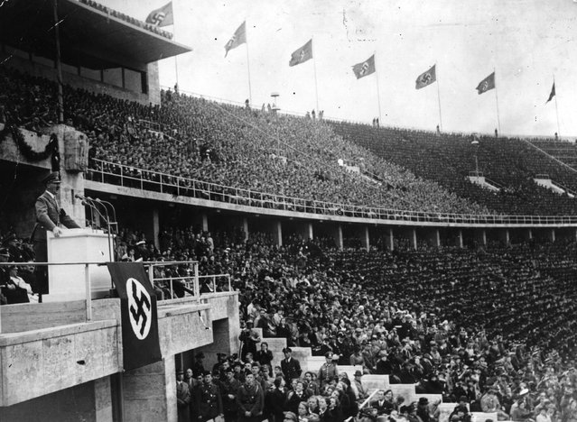 2nd May 1938:  Adolf Hitler (1889 - 1945) addressing thousands of supporters at a Nazi Rally held in the Berlin Stadium on May Day