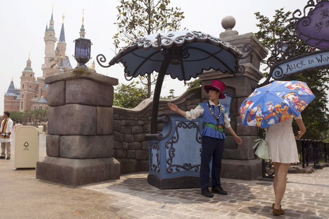 A visitor walks into the Alice in Wonderland maze on the eve of the opening of the Disney Resort in Shanghai, China, Wednesday, June 15, 2016. Disney will open its first resort in mainland China on Thursday. (Photo by Ng Han Guan/AP Photo)