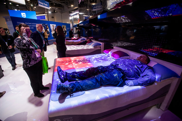 Visitors test the Climate 360 connected mattress at the Sleep Number 360 booth at the Sands during the 2020 International Consumer Electronics Show in Las Vegas, Nevada, USA, 09 January 2020. (Photo by Etienne Laurent/EPA/EFE)
