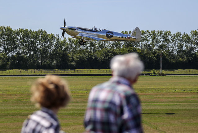 """A restored MK IX Spitfire takes off from Goodwood Aerodrome in Goodwood, England, Monday, August 5, 2019. A restored World War II Spitfire has taken off from an English aerodrome on the first leg of a planned 27,000 mile (43,000 kilometer) trip around the globe. Pilots Steve Brooks and Matt Jones hope to circle the world in about four months, with stops in 30 countries. Brooks says his biggest worry was the weather – and """"landing is always the tricky part"""". (Photo by Steve Parsons/PA Wire via AP Photo)"""