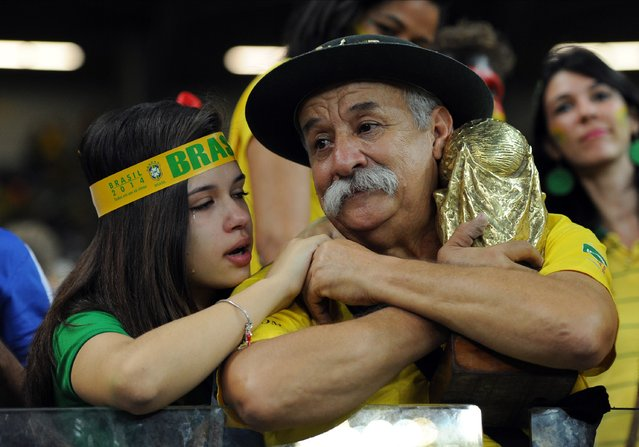 Brazil fans look dejected following the 2014 FIFA World Cup Brazil Semi Final match between Brazil and Germany at Estadio Mineirao on July 08, 2014 in Belo Horizonte, Brazil. (Photo by Chris Brunskill Ltd/Getty Images)