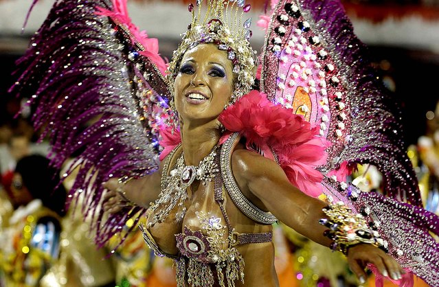 A dancer from the Aguia de Ouro samba school performs in Sao Paulo