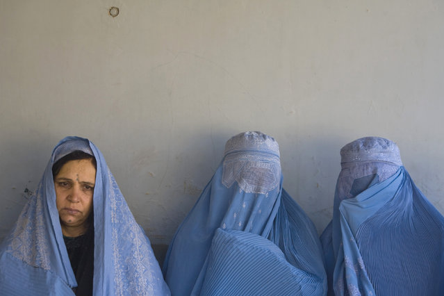 Afghan women sit in an orthopaedic centre in Herat, Afghanistan, November 5, 2009. (Photo by Morteza Nikoubazl/Reuters)