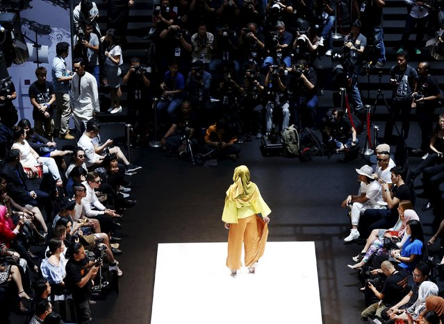 A model wears a creation by Anas Abdullah during the Islamic Fashion Festival at Kuala Lumpur Fashion Week in Kuala Lumpur, Malaysia, August 13, 2015. (Photo by Olivia Harris/Reuters)