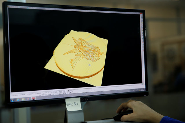 A sculptress from the Casa da Moeda do Brasil (Brazilian Mint) works on the Rio 2016 Olympic medal at her computer in Rio de Janeiro, Brazil, June 28, 2016. (Photo by Sergio Moraes/Reuters)