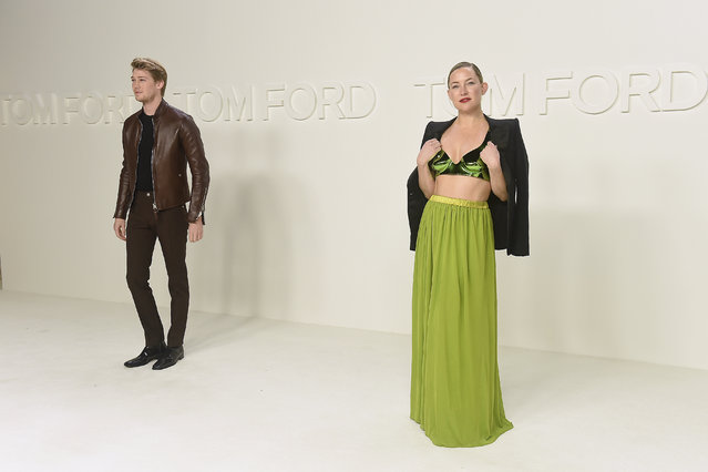 Kate Hudson, right, and Joe Alwyn attend the Tom Ford show at Milk Studios during NYFW Fall/Winter 2020 on Friday, February 7, 2020, in Los Angeles. (Photo by Jordan Strauss/Invision/AP Photo)