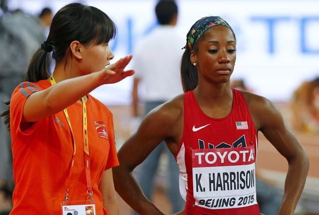 Kendra Harrison of the U.S. (R) reacts after being disqualified for false start in her women's 100 metres hurdles semi-final during the 15th IAAF World Championships at the National Stadium in Beijing, China, August 28, 2015. (Photo by Damir Sagolj/Reuters)
