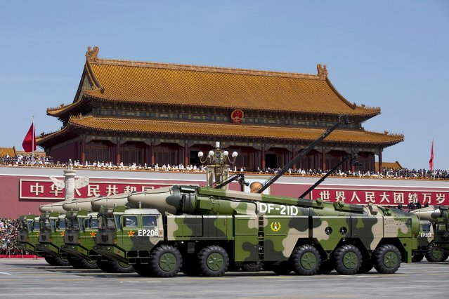 Chinese military vehicles carrying DF-21D anti-ship ballistic missiles, potentially capable of sinking a U.S. Nimitz-class aircraft carrier in a single strike, travel past Tiananmen Gate during a military parade to commemorate the 70th anniversary of the end of World War II in Beijing Thursday September 3, 2015. (Photo by Andy Wong/Reuters)