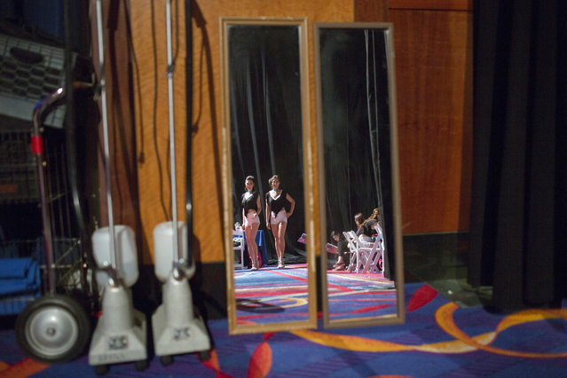 "Contestants Stephanie Hau and Lili Wat practice their catwalk technique with two mirrors backstage before the start of the pageant. Chinese culture teaches people to be more reserved, while America prides itself on freedom of speech. ""In the Chinese culture, you don't get to speak your mind too much. (Photo and caption by John Brecher/Sahra Vang Nguyen/NBC News)"