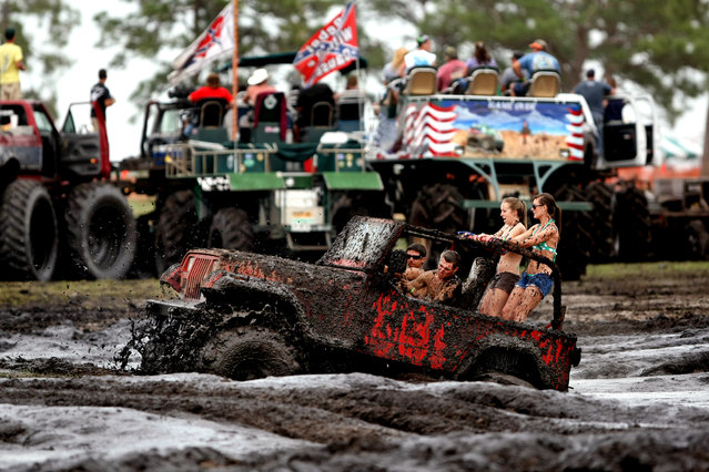 A jeep gets stuck in the mud bog. Getting stuck is usually not a problem: There are plenty of owners with larger trucks willing to pull out stranded vehicles. (Photo by Gary Coronado/The Palm Beach Post)