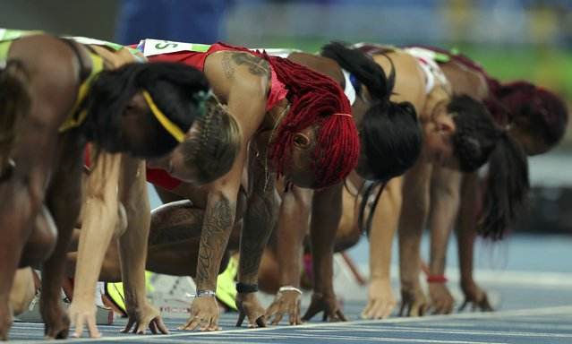 2016 Rio Olympics, Athletics, Preliminary, Women's 100m Round 1, Olympic Stadium, Rio de Janeiro, Brazil on August 12, 2016. Athletes start the race in heat 6. (Photo by Gonzalo Fuentes/Reuters)
