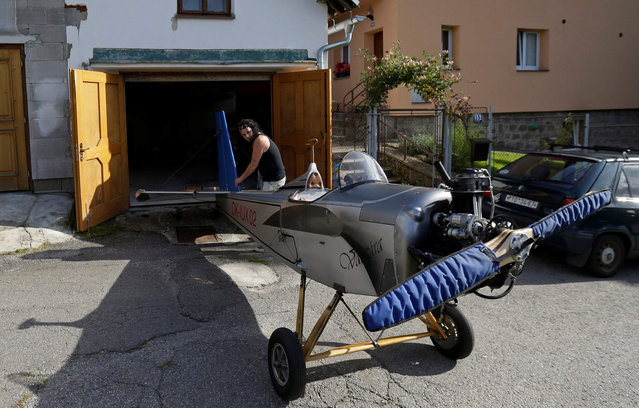 Aviator Frantisek Hadrava moves Vampira, an ultralight plane based on the U.S.-design of light planes called Mini-Max, out of a garage in the village of Zdikov, Czech Republic, August 23, 2016. (Photo by David W. Cerny/Reuters)